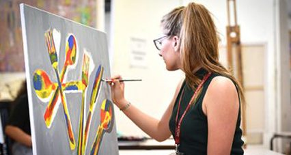 Art student painting at easel