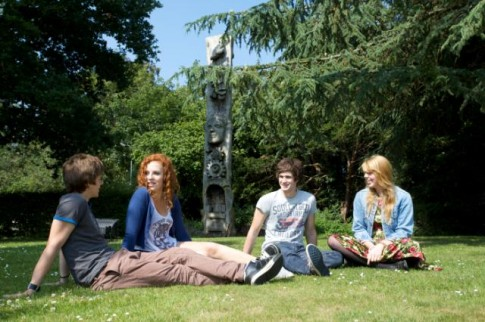 Students chatting on campus front lawn