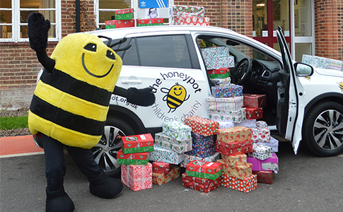 Honeypot charity mascot collecting shoebox donations