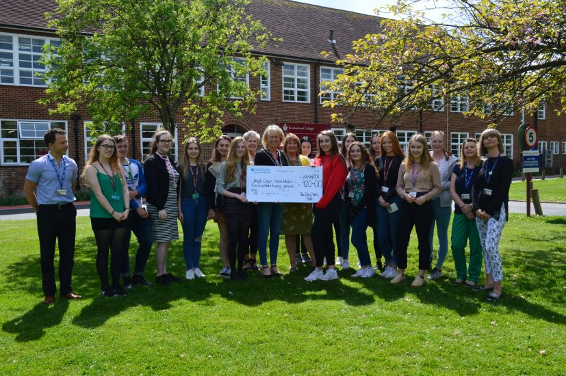 Early Years students present cheque to Sally Tailor