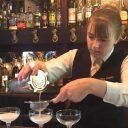 Chloe serving cocktails at bar
