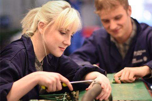 Marine engineering students working on engine