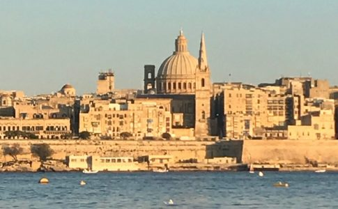 Shoreline in Malta with old churches on