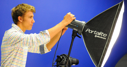 Photography student setting up studio