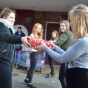 Students packing shoeboxes for Honeypot charity
