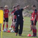Football Academy coach Tom Prodomo training team