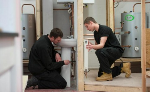 Construction Students installing radiator