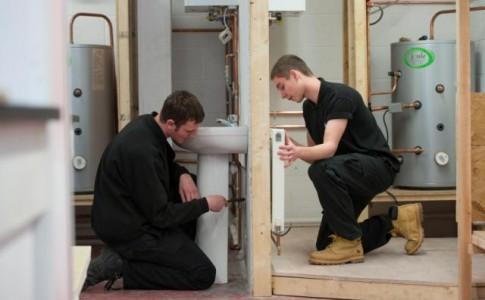 Construction Students installing radiator