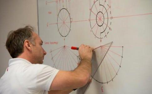 Teacher drawing diagram on whiteboard