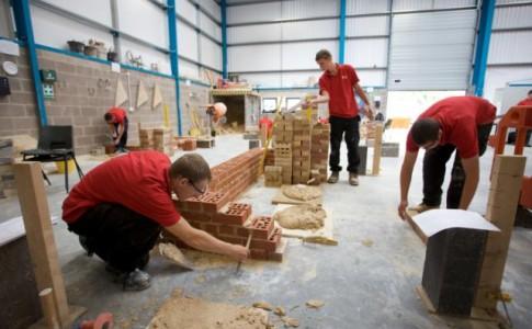 Construction Student laying bricks