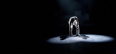 Person in spotlight on stage