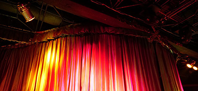 Red curtain across stage