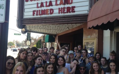 Students pose in front of La La Land film set.
