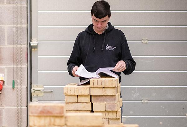 Construction Student with bricks