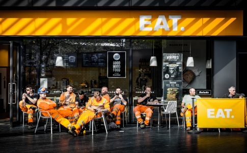 Cafe with construction workers outside