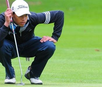 Golfer preparing to putt