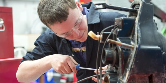 student fixing a gearbox