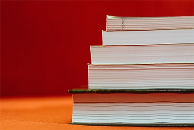Stack of books on red background
